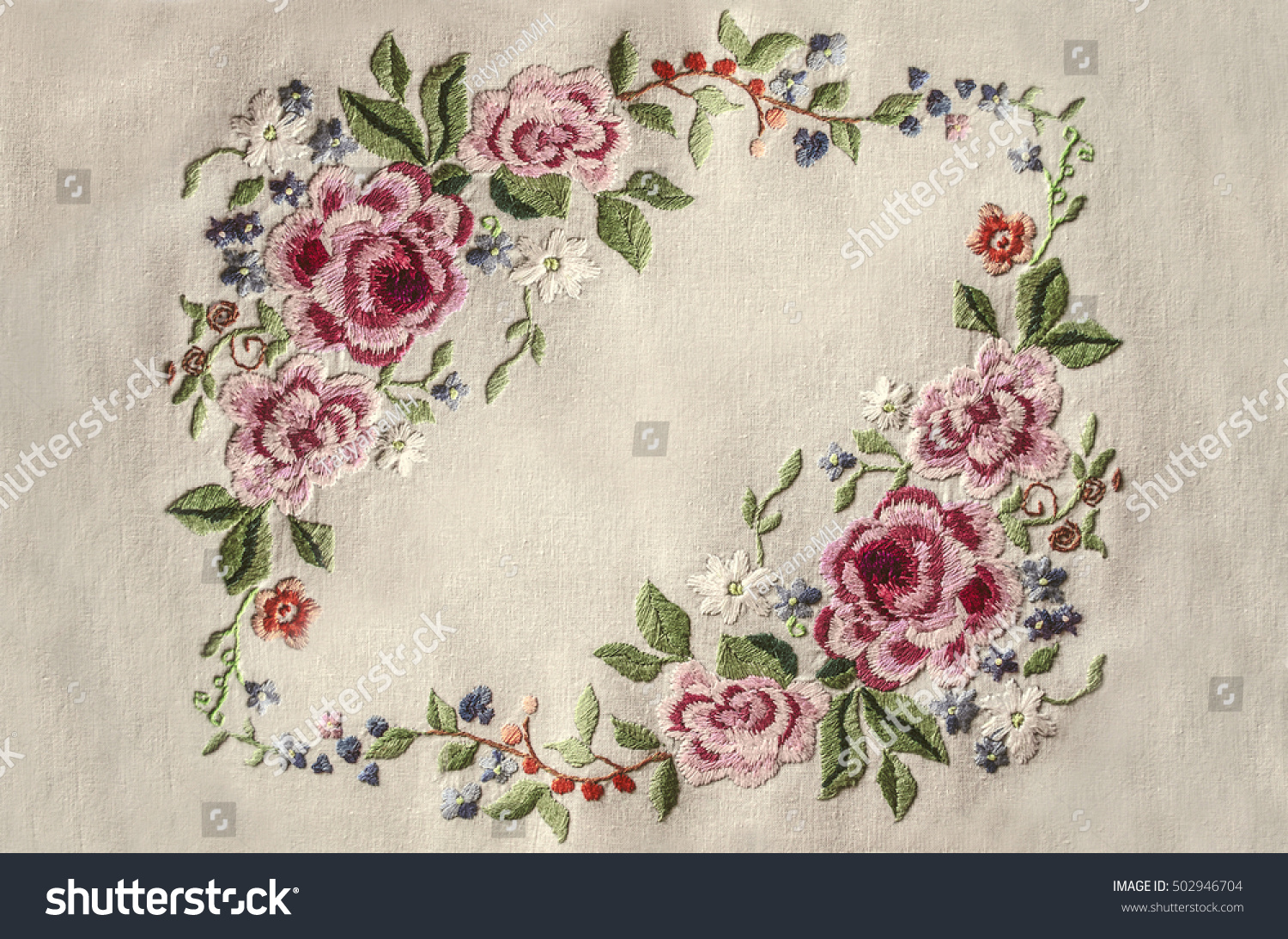 Frame of embroidery pink roses with other flowers and