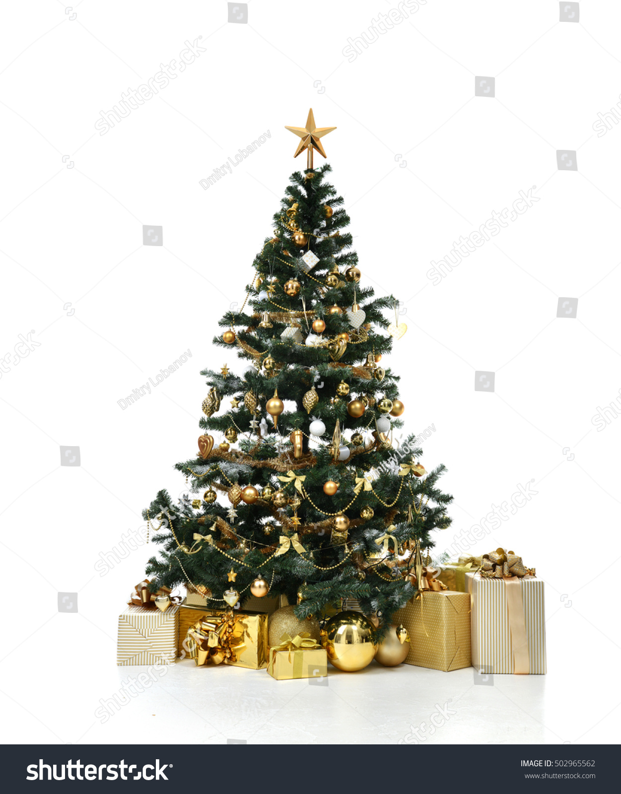 Decorated gold Christmas tree with golder patchwork ornament artificial star hearts presents for new year isolated on white background #502965562
