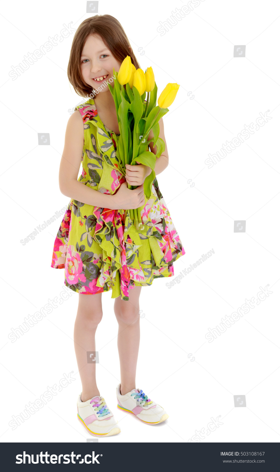 6badb88da5b82 Adorable little Caucasian girl in summer dress holding a bouquet of yellow  tulips.Isolated on white background. - Image