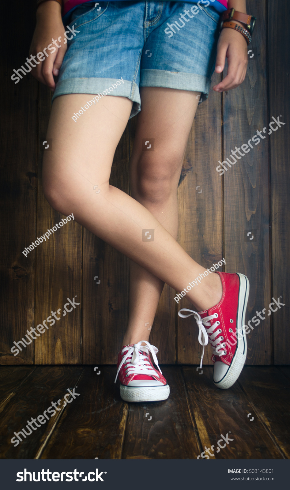 Girls Wear Red Shoes Short Jeans Stock
