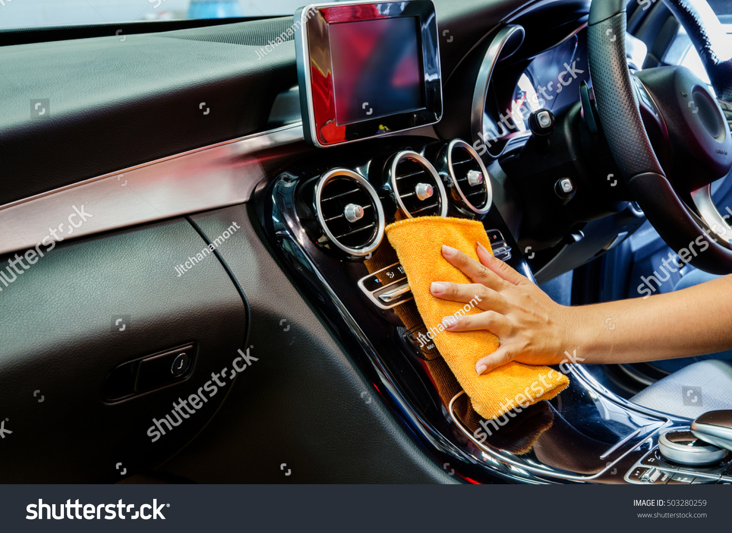 hand orange microfiber cloth cleaning interior stock photo 503280259 shutterstock. Black Bedroom Furniture Sets. Home Design Ideas