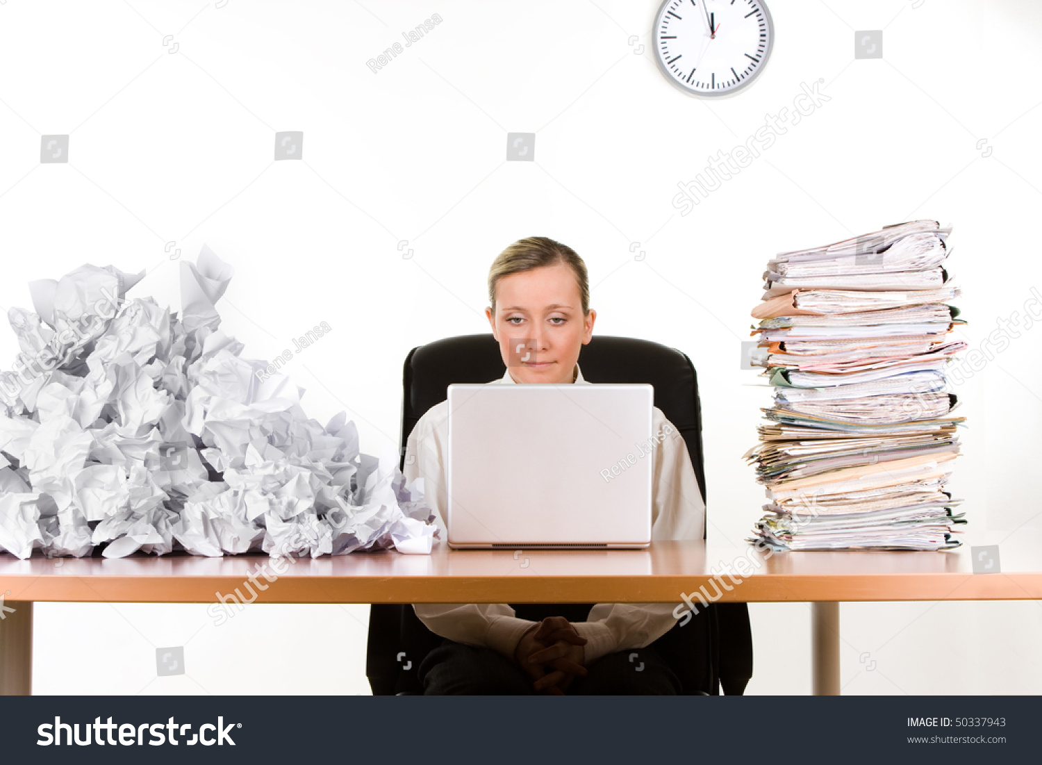 Businesswoman stack paperwork pile crumpled papers stock photo businesswoman with stack of paperwork pile of crumpled papers working on a laptop computer publicscrutiny Images