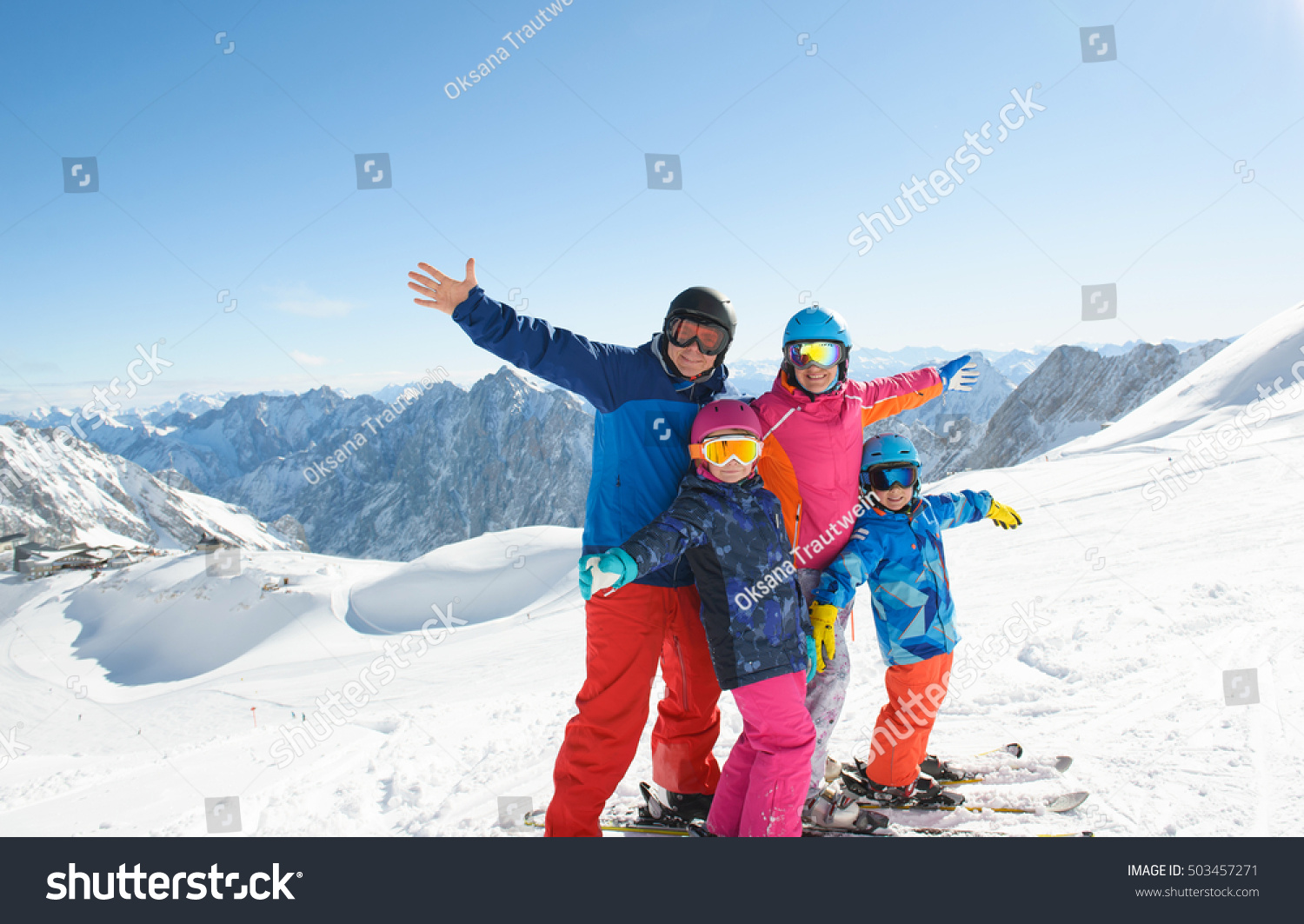 Happy family enjoying winter vacations mountains stock for Winter vacations in the us