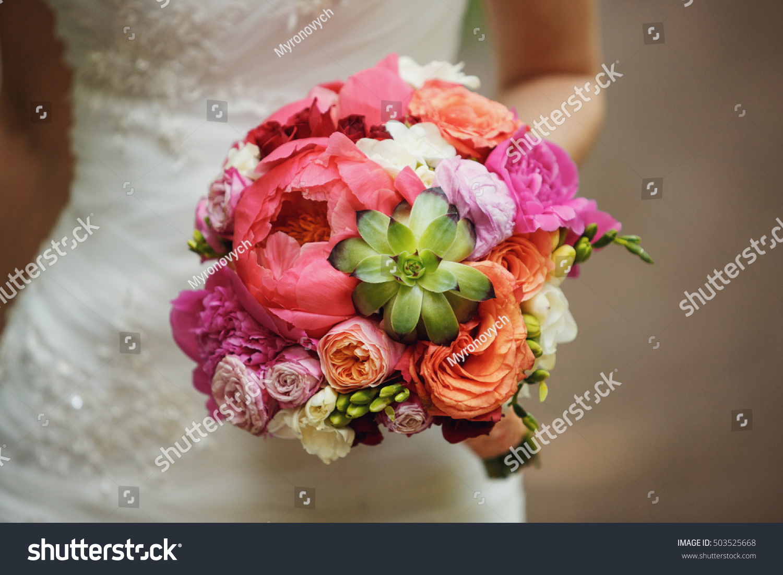 Amazing bridal bouquet colored flowers stock photo royalty free amazing bridal bouquet of colored flowers izmirmasajfo