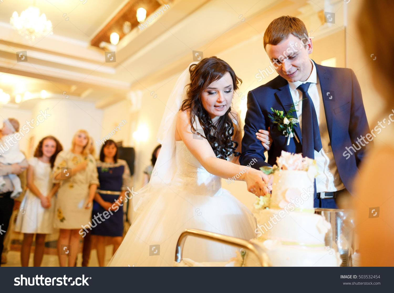 Happy Couple Cut Wedding Cake Stock Photo (Edit Now) 503532454 ...