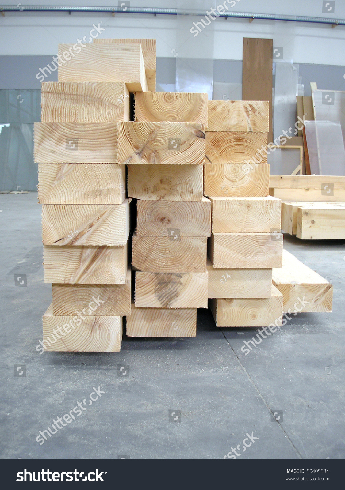 A pile of wood plank boards in carpentry factory stock