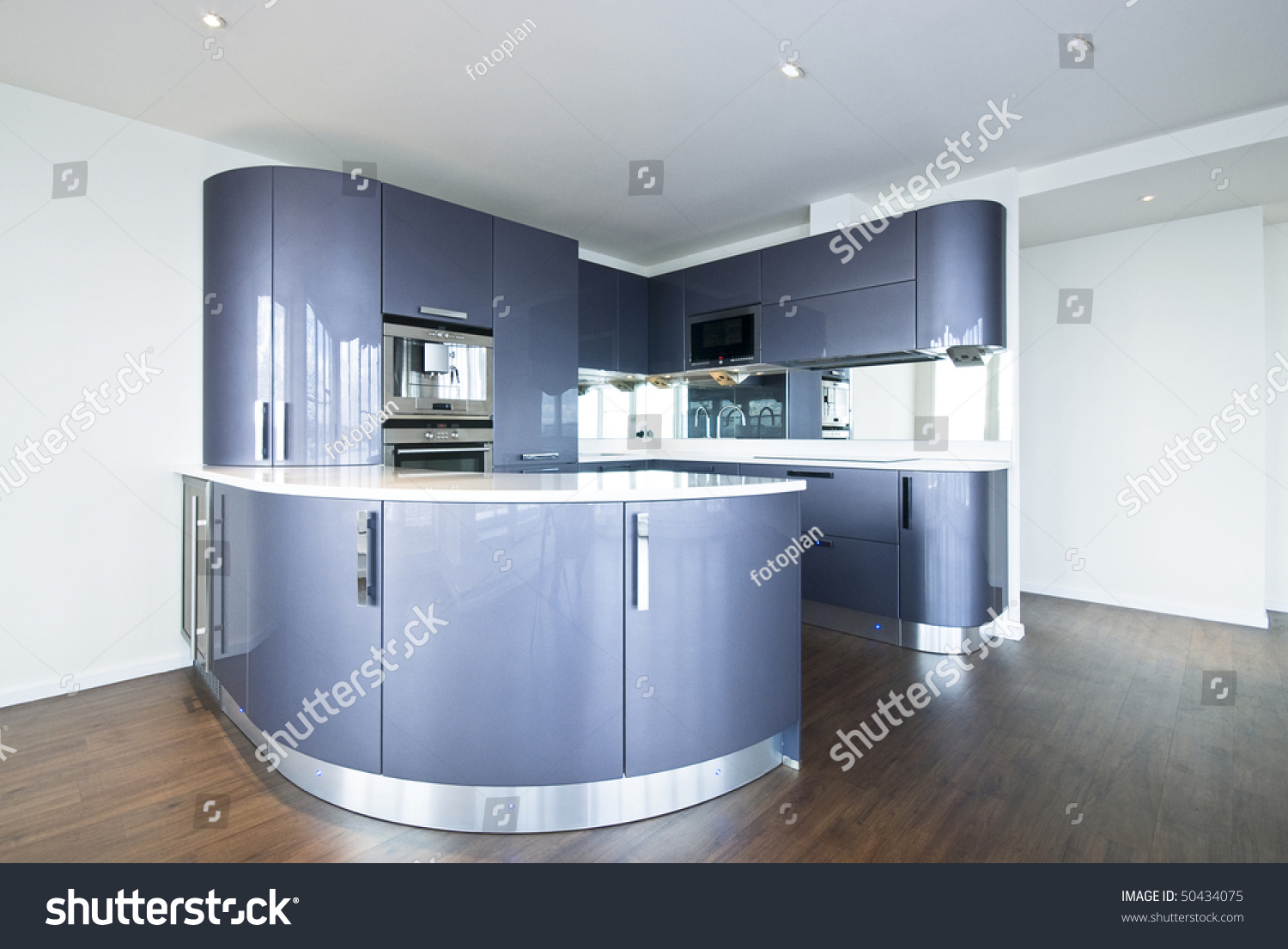 Ultra Modern Designer Kitchen With Modern Appliances In Metal Blue And Gray