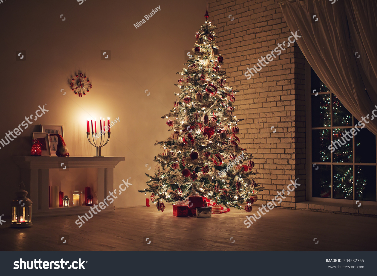 Feast of Christmas. Beautifully decorated house with a Christmas tree ipodarkami underneath #504532765