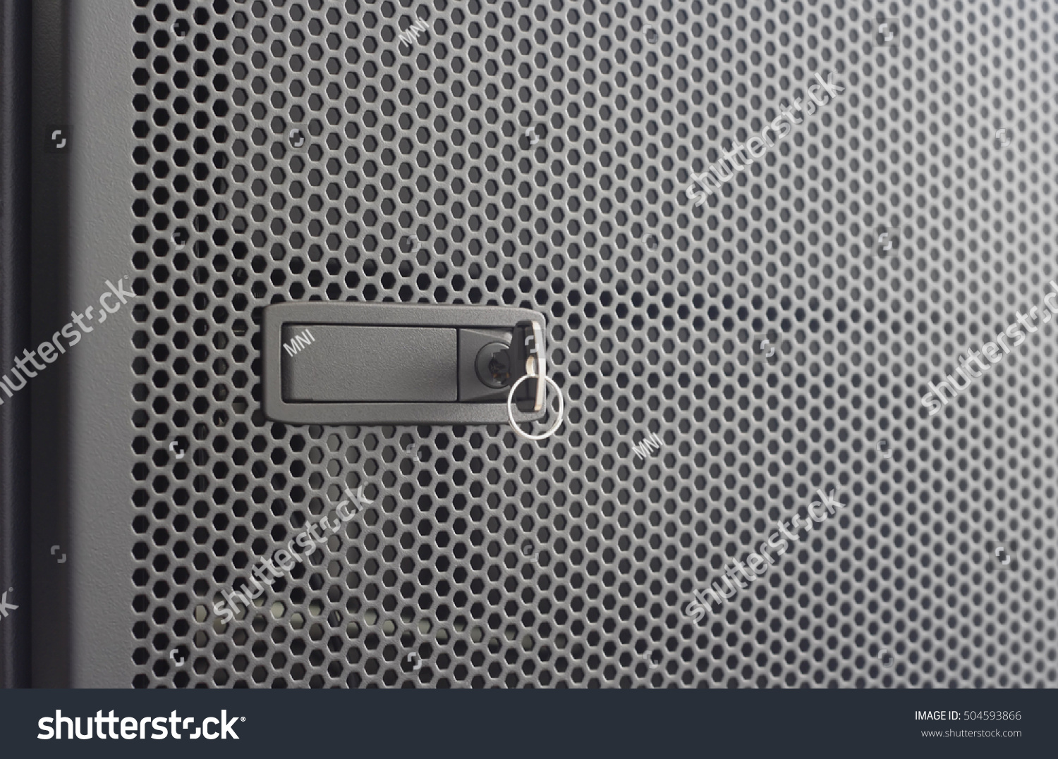 Superbe Door Perforated Of Server Rack Cabinet. The Key Is Inserted Into The Door  Lock.