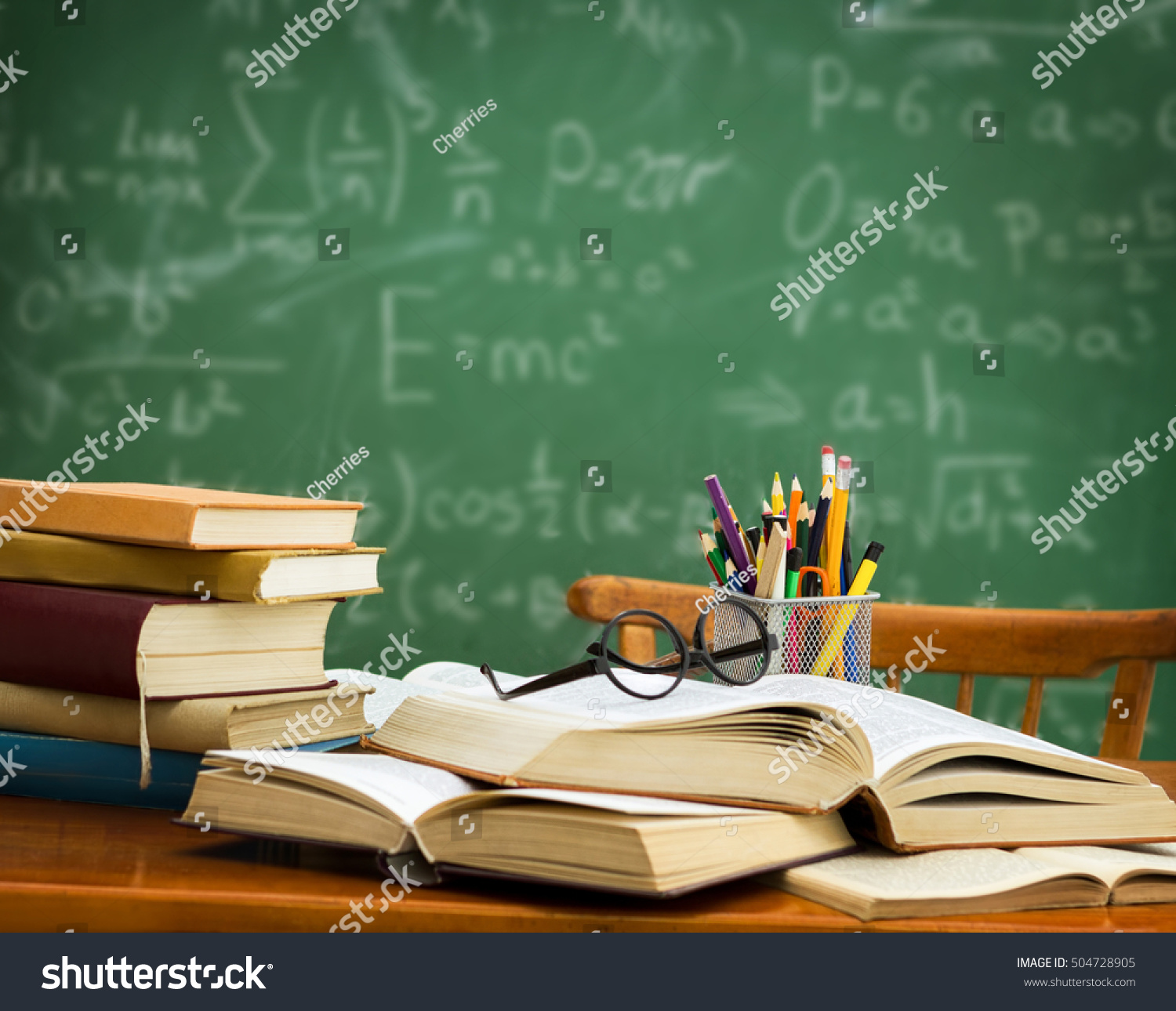 pile books glasses pencil holder on stock photo
