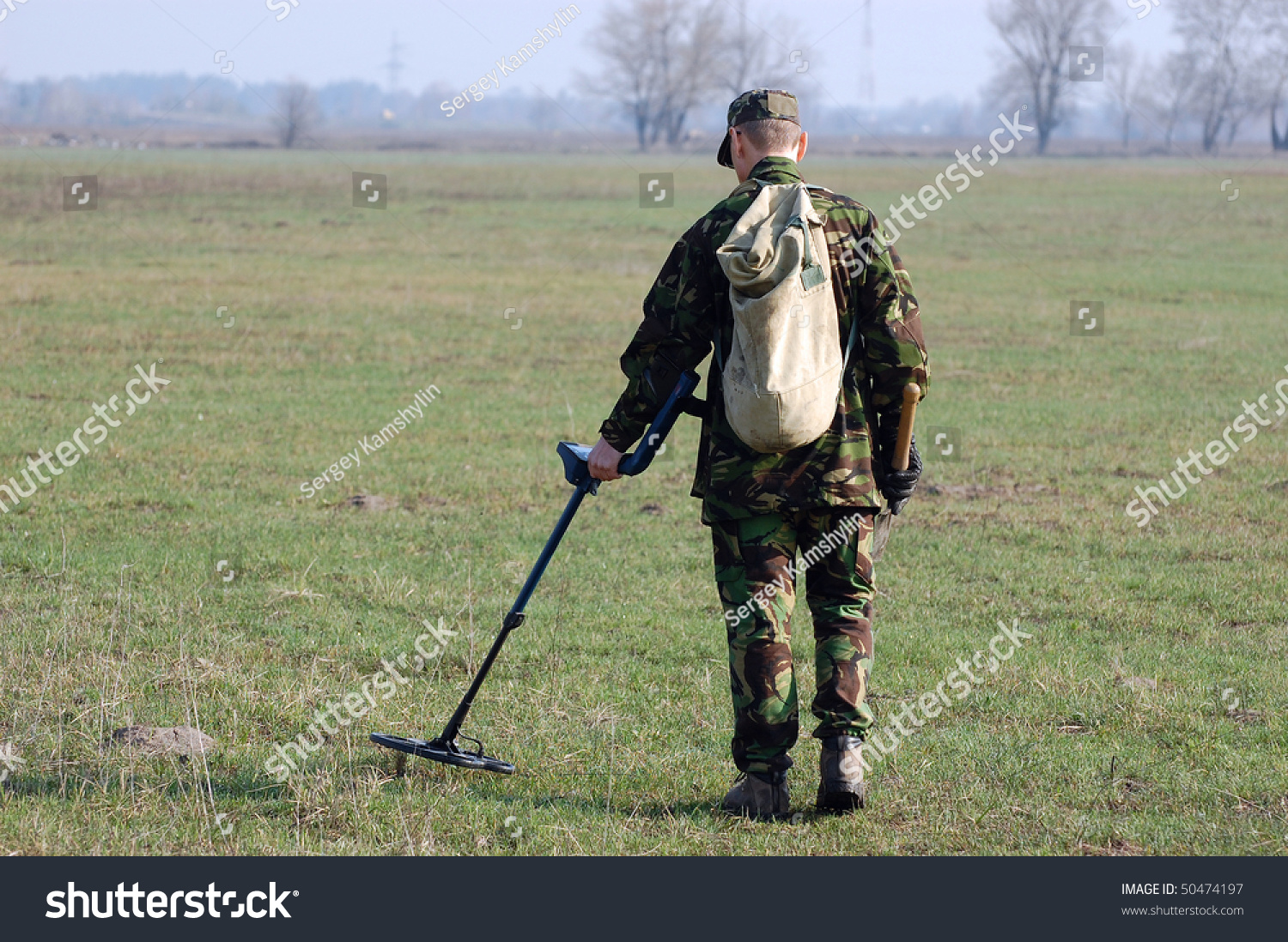 Jew Detector: Military Archeology Man Metal Detector On Stock Photo