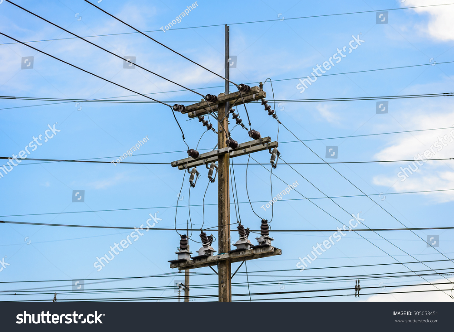 Old Electricity Post Against Blue Sky Stock Photo (Royalty Free ...