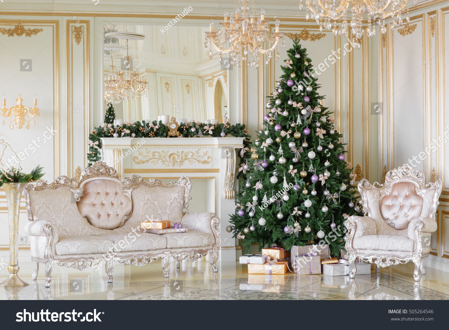 Christmas morning classic apartments with a white fireplace decorated tree bright sofa large windows