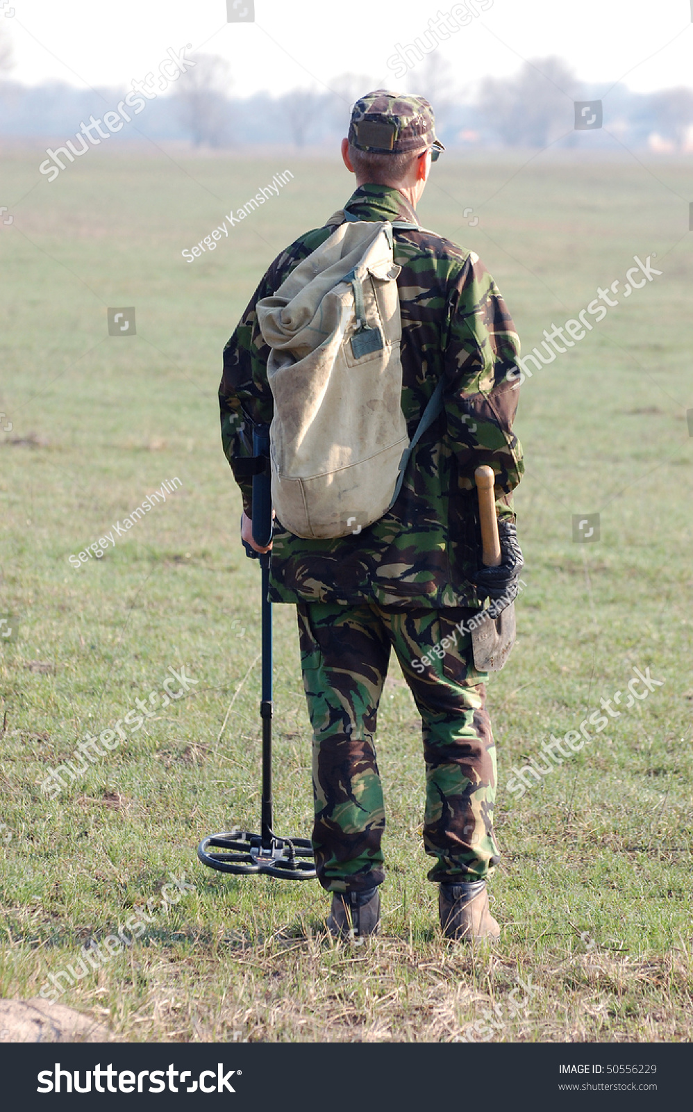 Jew Detector: Military Archeology. Man With Metal Detector On The
