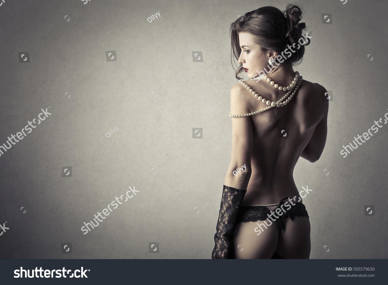 Erotic women wearing pearls