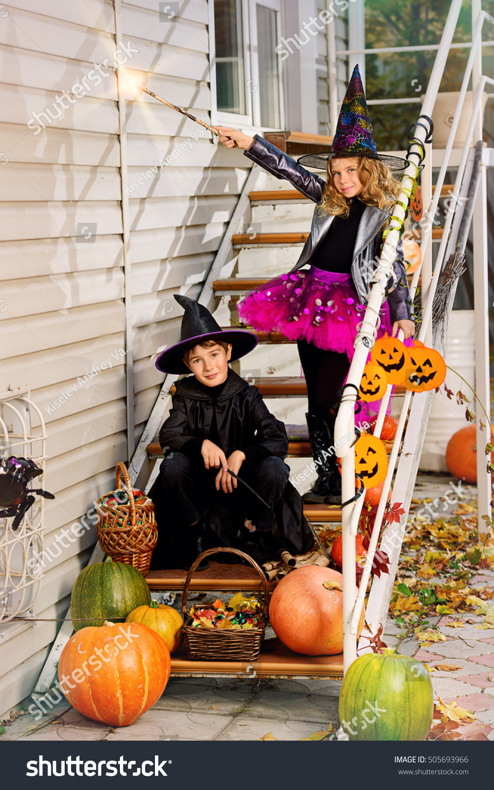 Happy children in a costumes of witches and wizards celebrating halloween. Trick or treat. Halloween party. #505693966