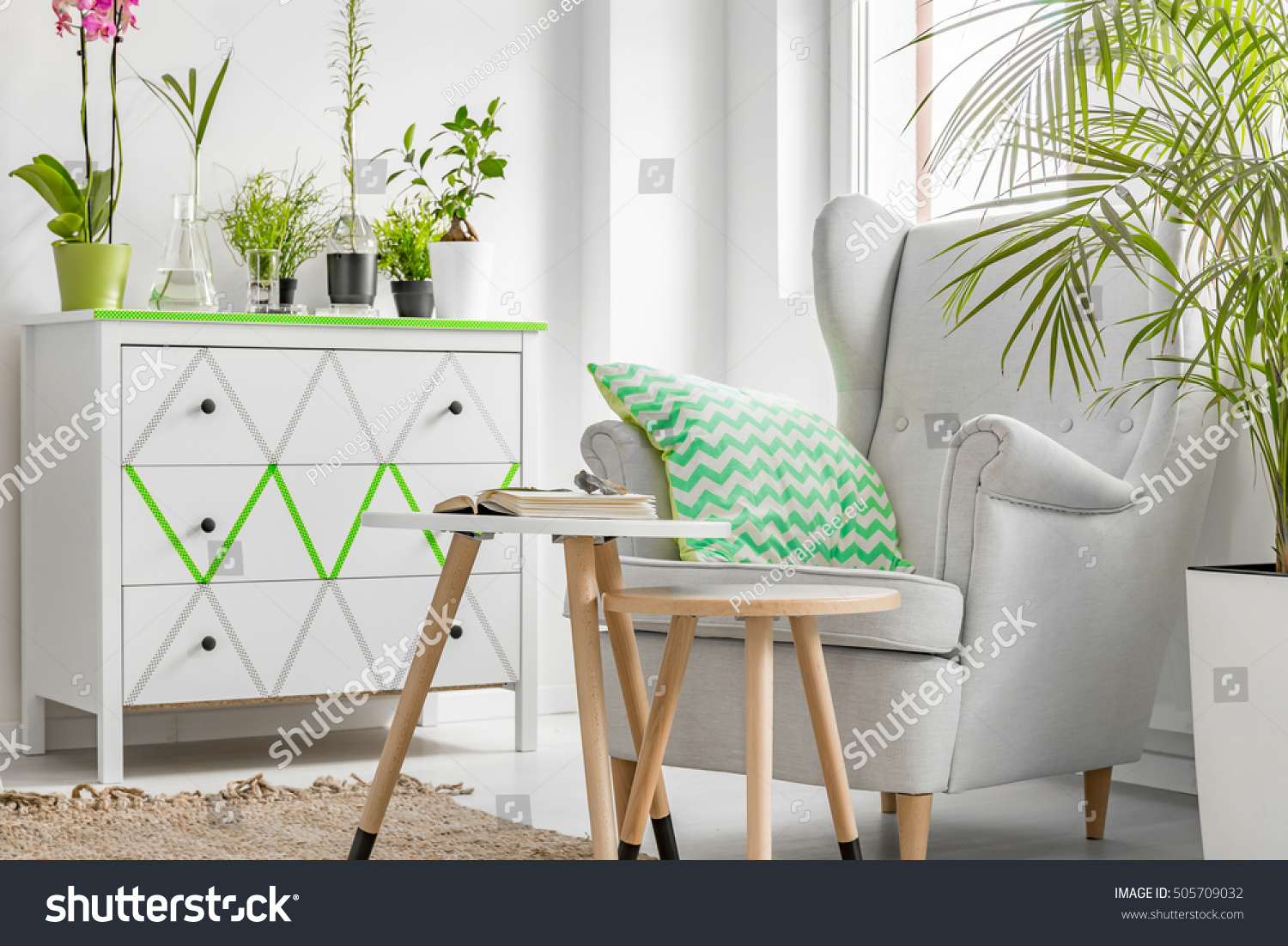 Room corner comfortable armchair wooden coffee stock photo room corner with comfortable armchair wooden coffee tables and plants geotapseo Gallery