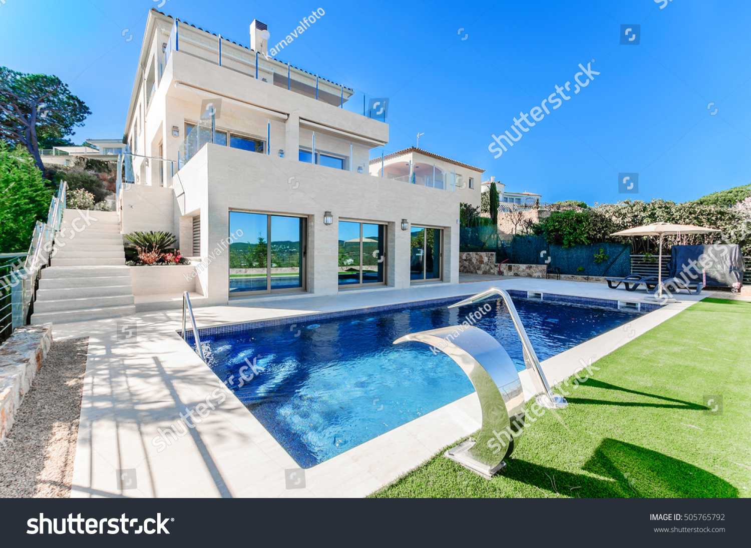 Luxury modern house with swimming pool with waterfall jet house marble