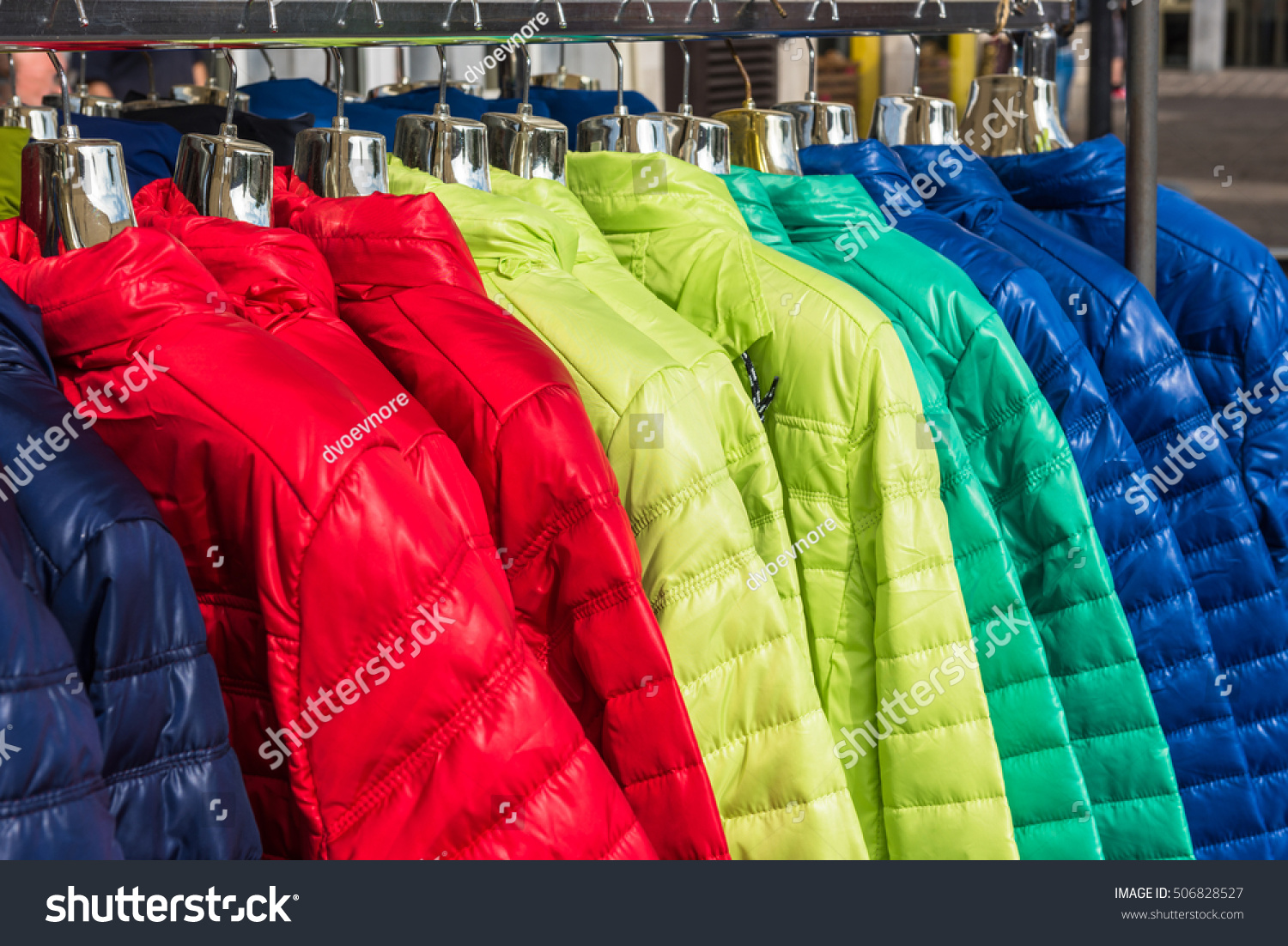 Bright Winter Clothes Hanging Fashion Store Stock Photo ...