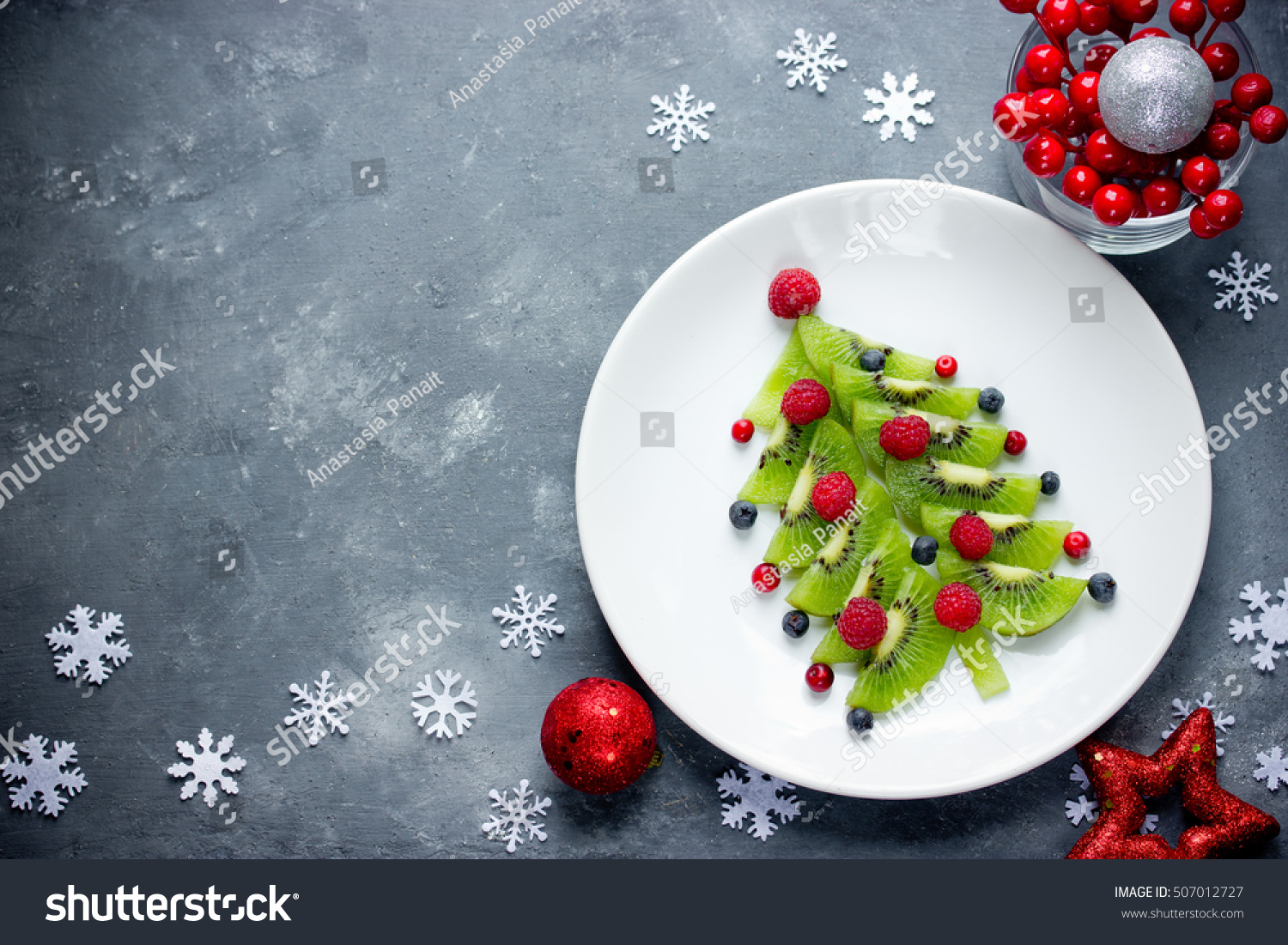 Funny edible Christmas tree, Christmas breakfast idea for kids. Beautiful Christmas and New Year food background top view blank space for text #507012727