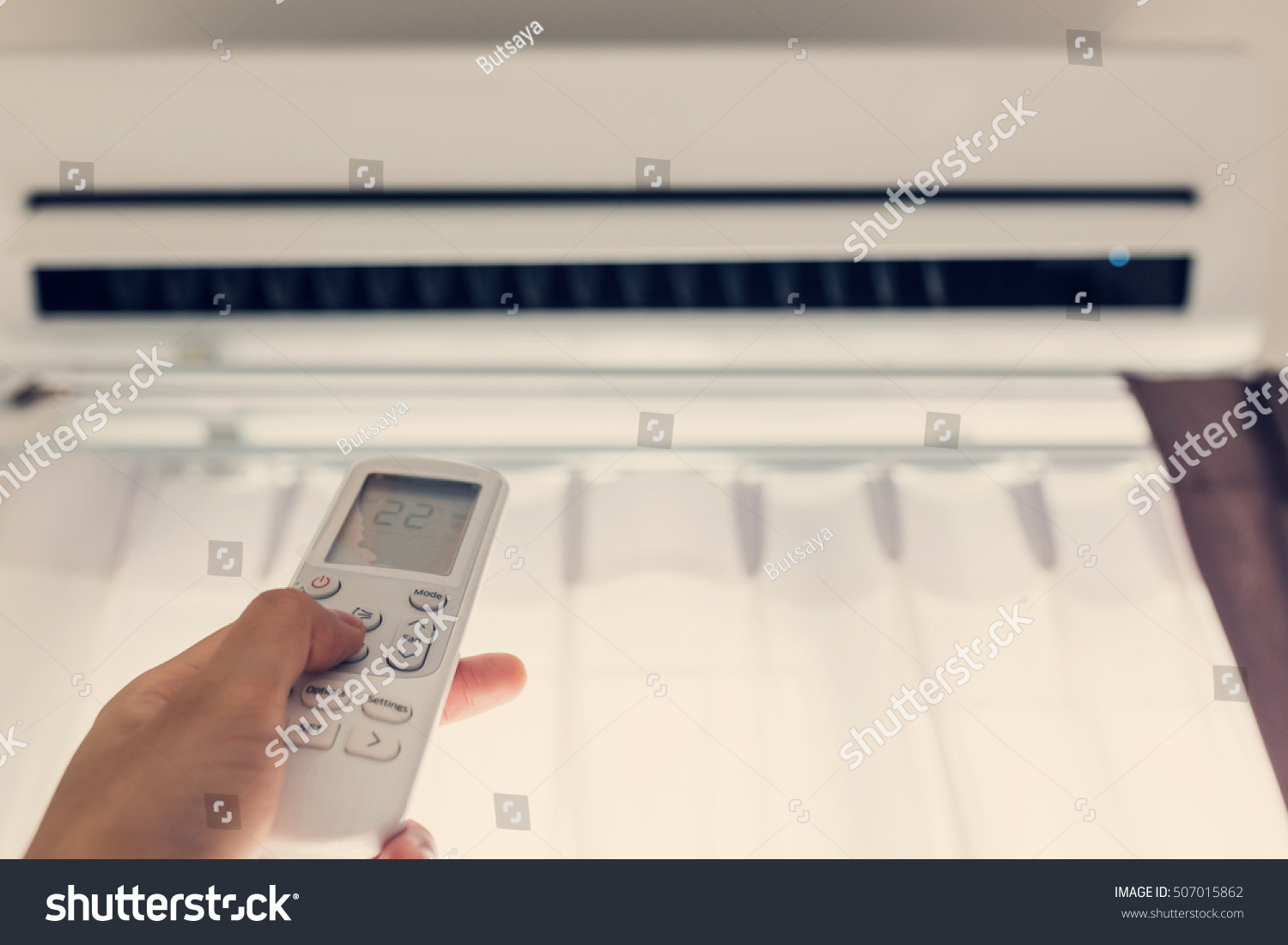 #826849 Air Conditioner Inside Room Woman Operating Stock Photo  Top of The Line 12664 Inside Room Air Conditioner picture with 1500x1101 px on helpvideos.info - Air Conditioners, Air Coolers and more