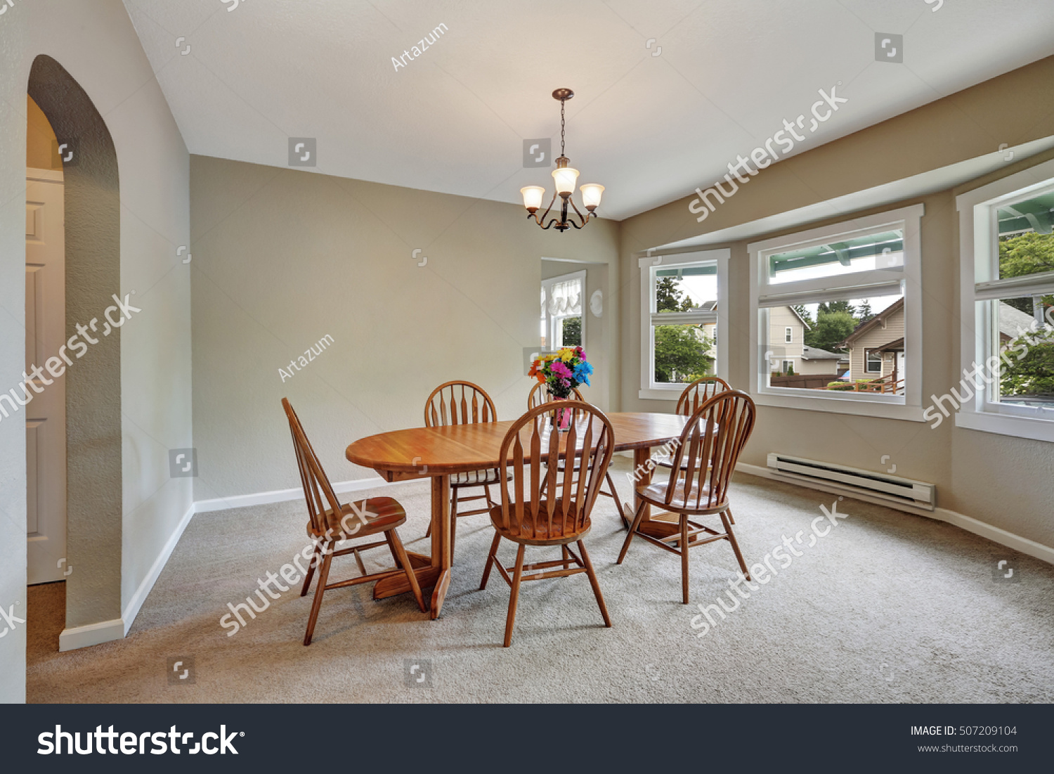 Beige Dining Room Interior With Round Wall Carpet Floor Wooden