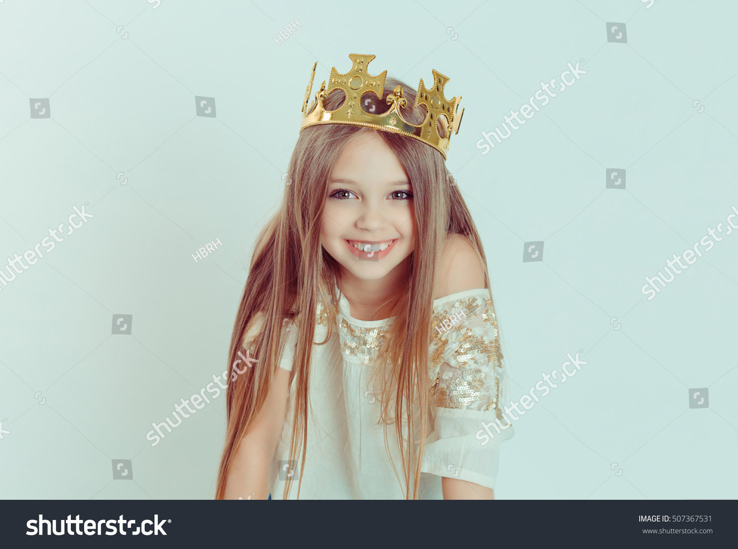 Young girl cute smile wearing crown stock photo edit now 507367531 young girl with a cute smile wearing a crown and a white dress on holiday isolated izmirmasajfo