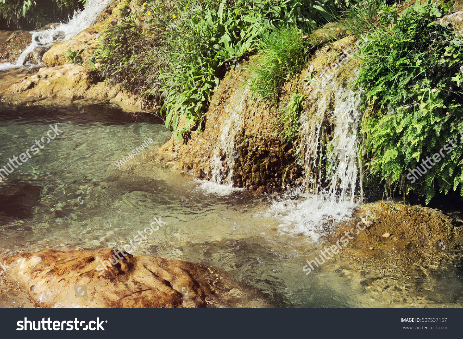 Waterfall green water pond stock photo 507537157 for Green water in pond