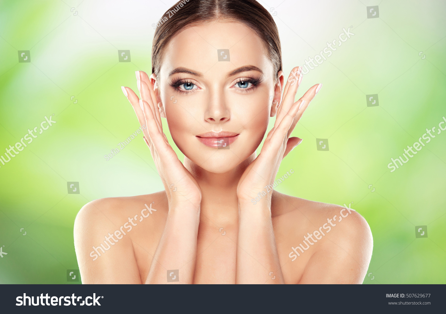 Beautiful Young Woman with Clean Fresh Skin touch own face Facial treatment Cosmetology beauty and spa