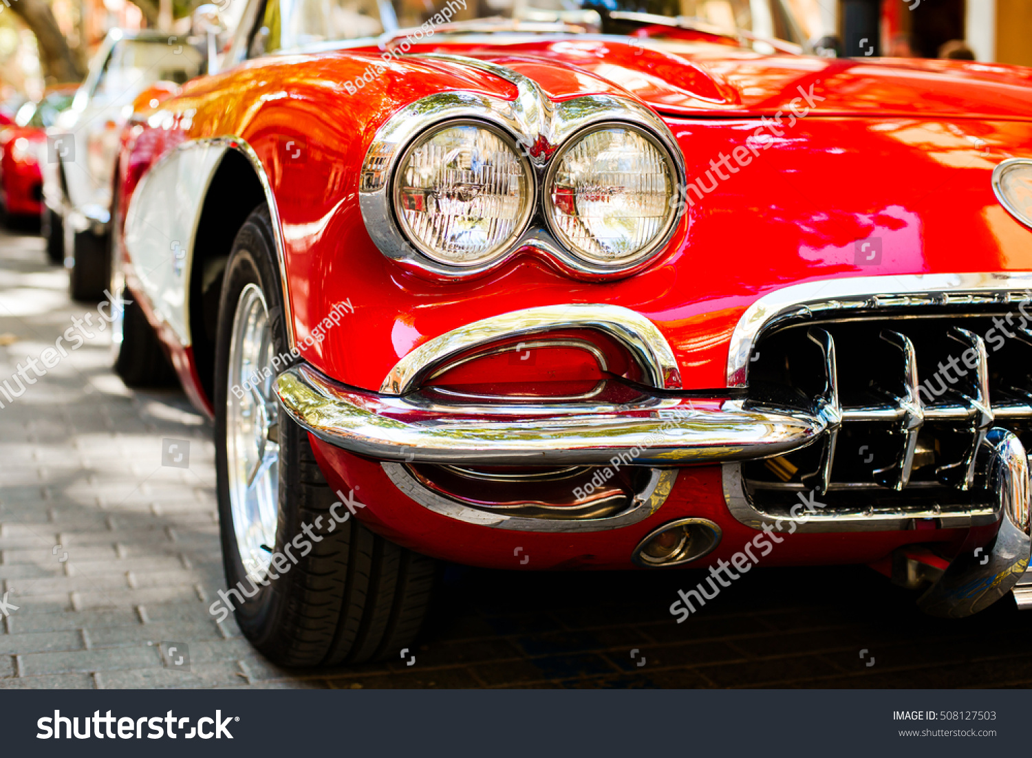 Close-up of headlights of red vintage car. Exhibition #508127503