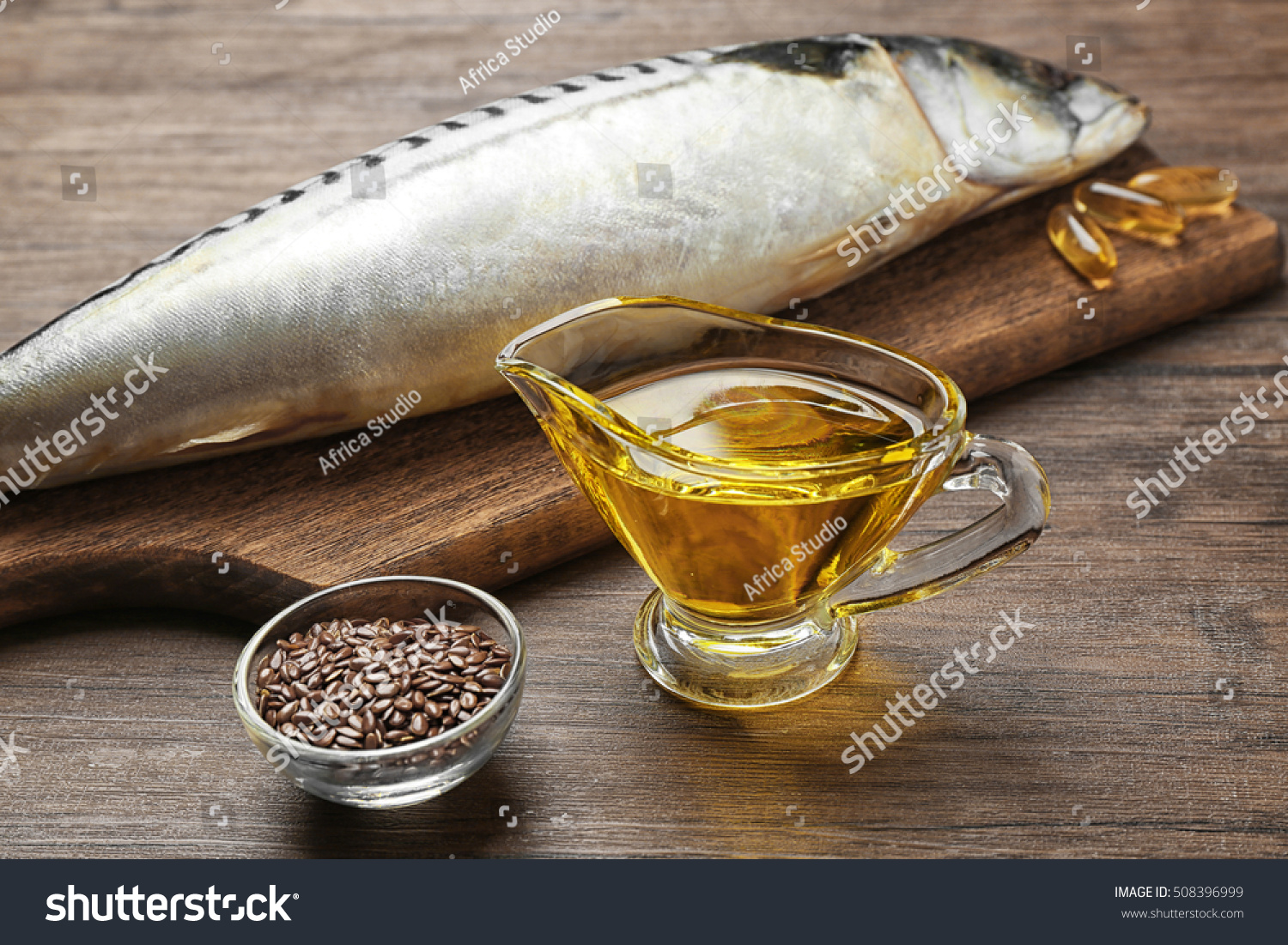 Fish oil with flax grain and fish on wooden background #508396999