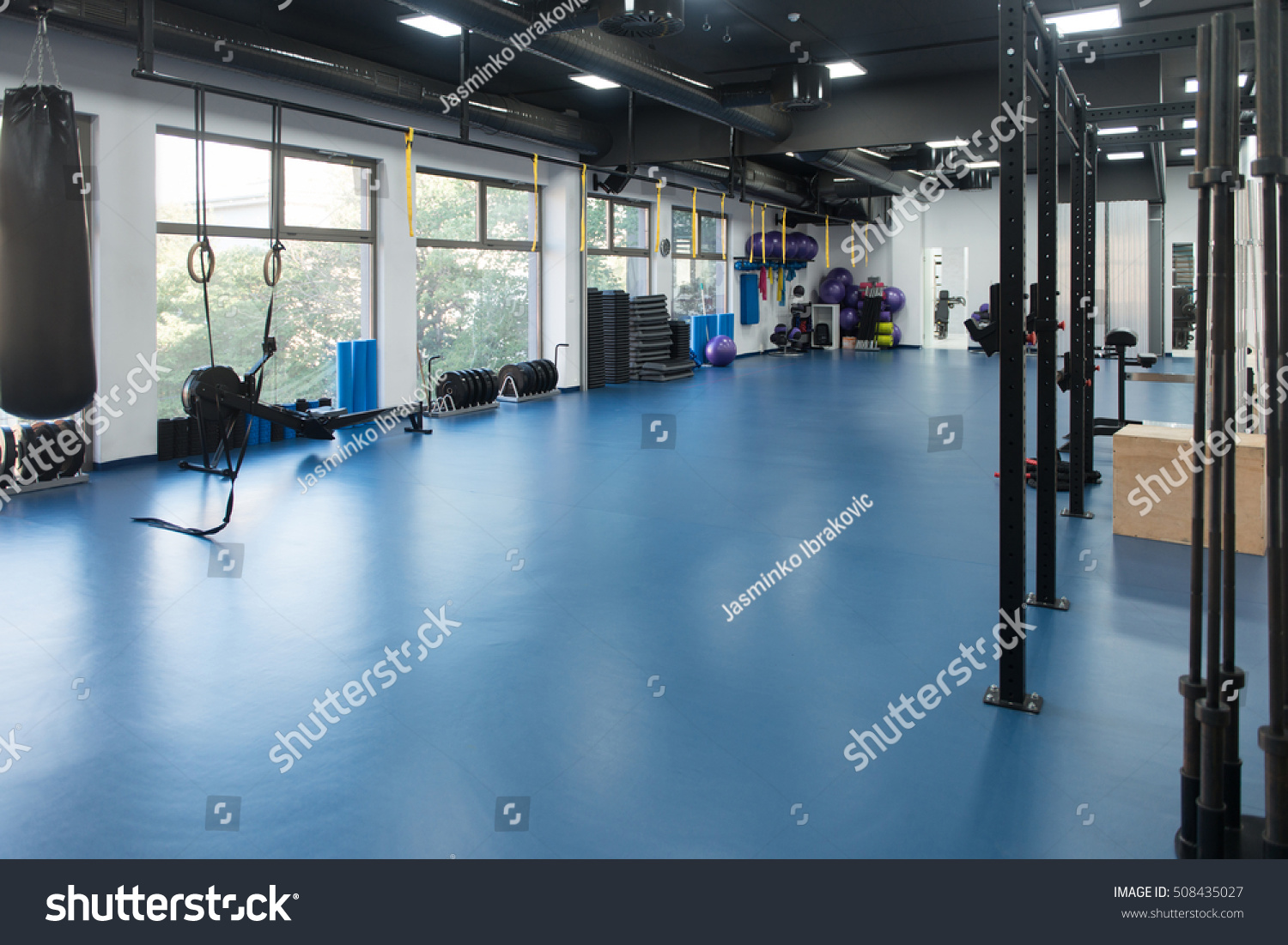 Modern gym room fitness center equipment stock photo