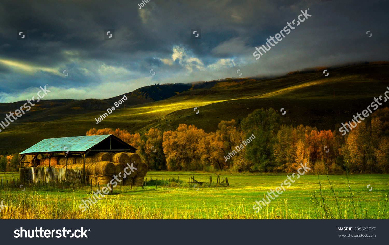 Hay Barn Frames Scene Against Foothills Stock Photo (Edit Now