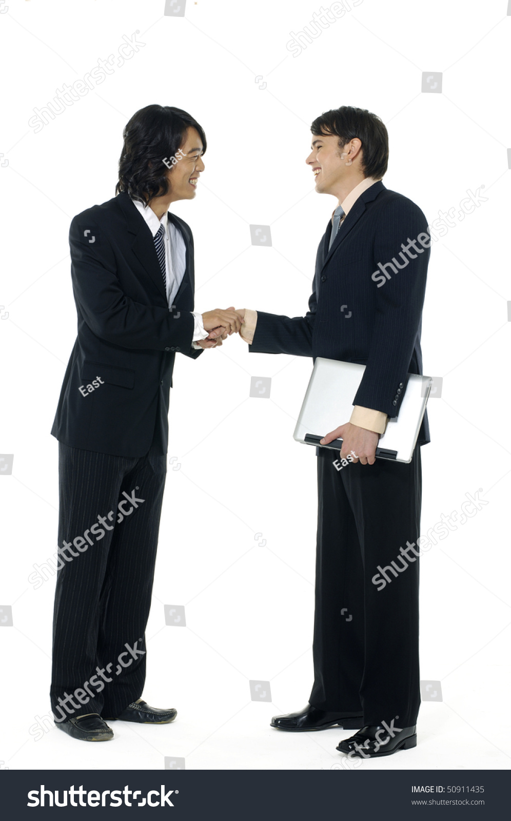 Isolated Studio Shot Of Two Businessmen Shaking Hands In A Warm