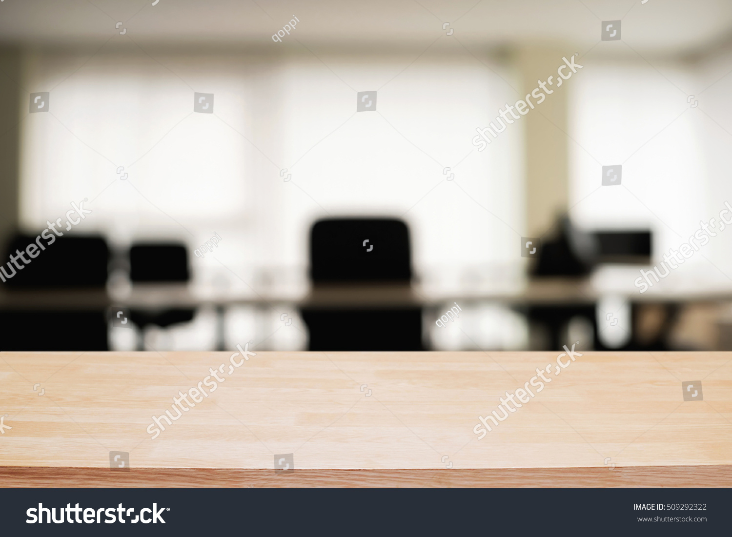 Empty Wooden Desk Space Over Blurred Office Or Meeting Room Background Product Display