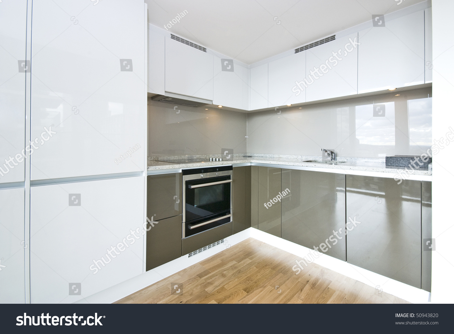 Modern fully fitted kitchen kitchen appliances stock photo for Modern fitted kitchen