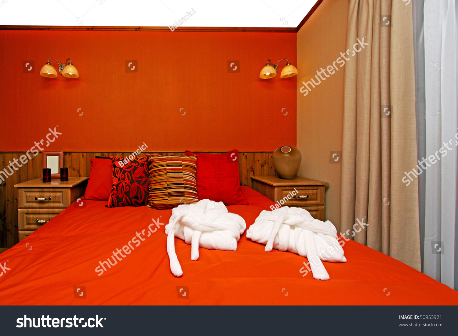 retro bedroom with warm colors and colorful sheets stock photo