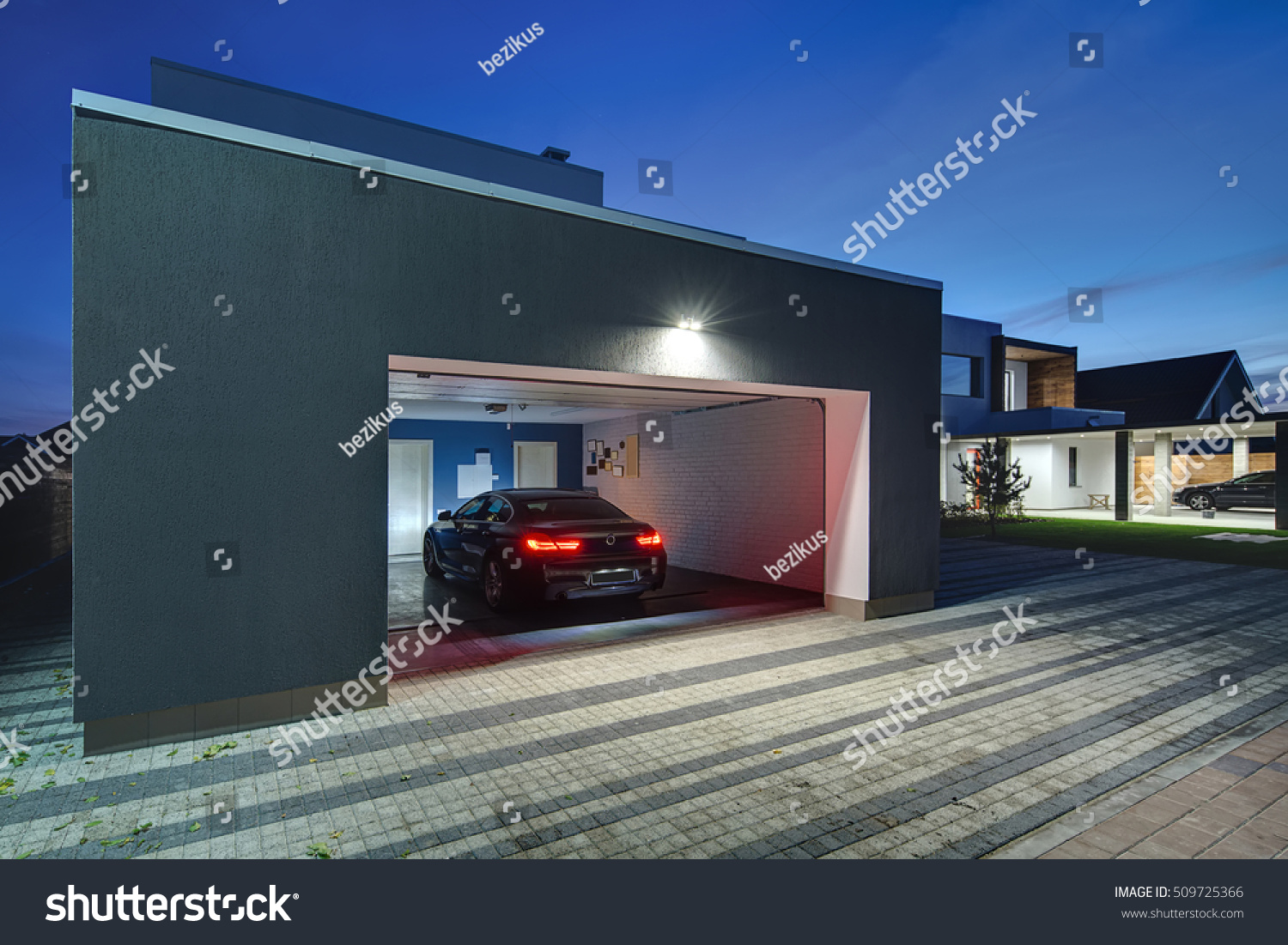 Entrance garage shining lamps modern country stock photo for Entrance from garage to house
