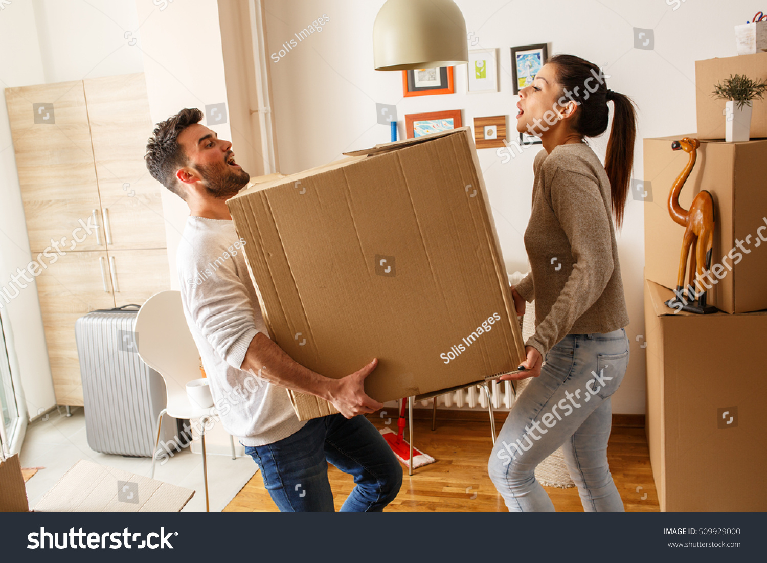 Young couple carrying big cardboard box stock photo 509929000 shutterstock - Young couple modern homes ...