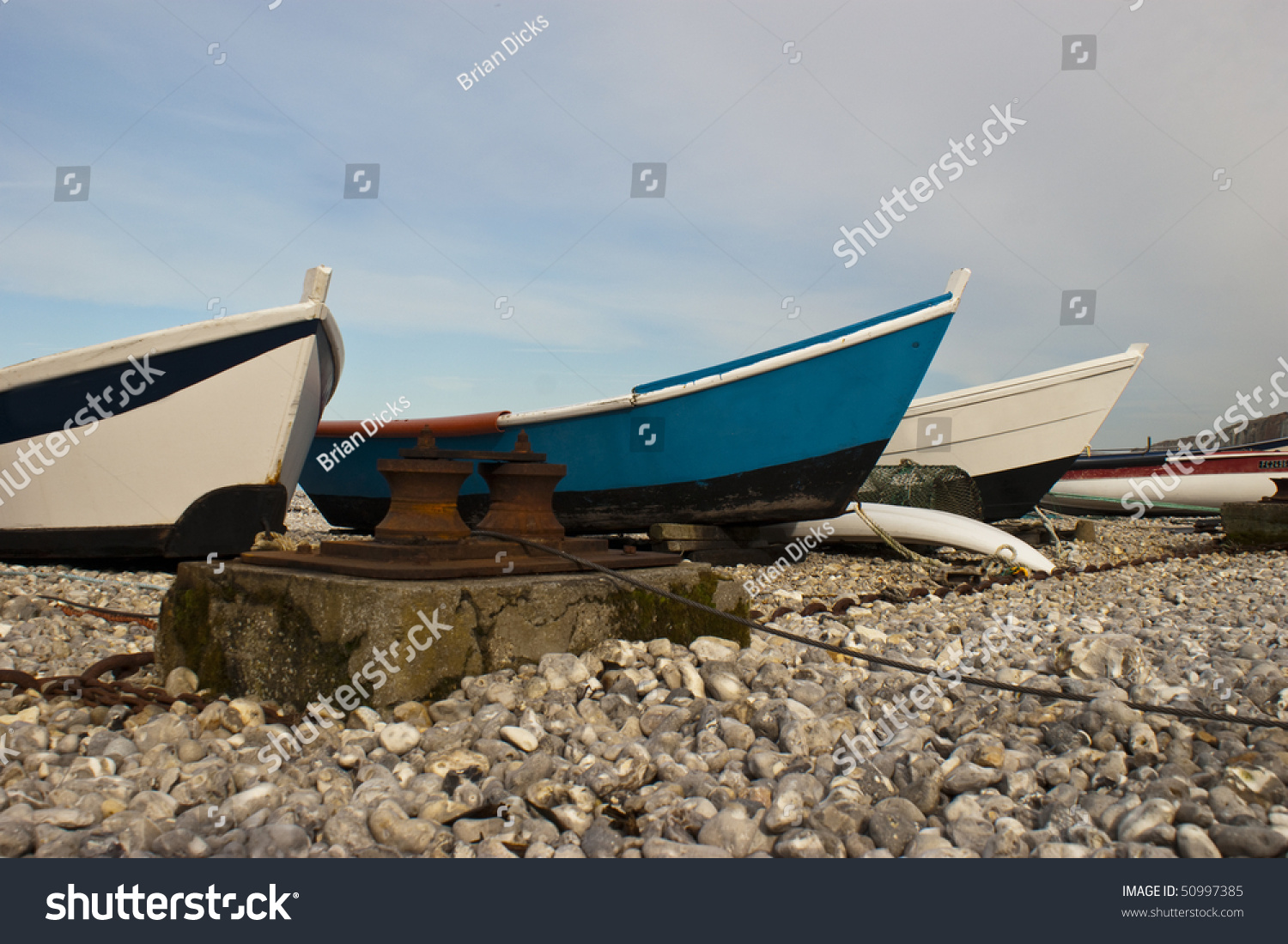 Row inshore fishing boats pulled on stock photo 50997385 for Fishing row boats