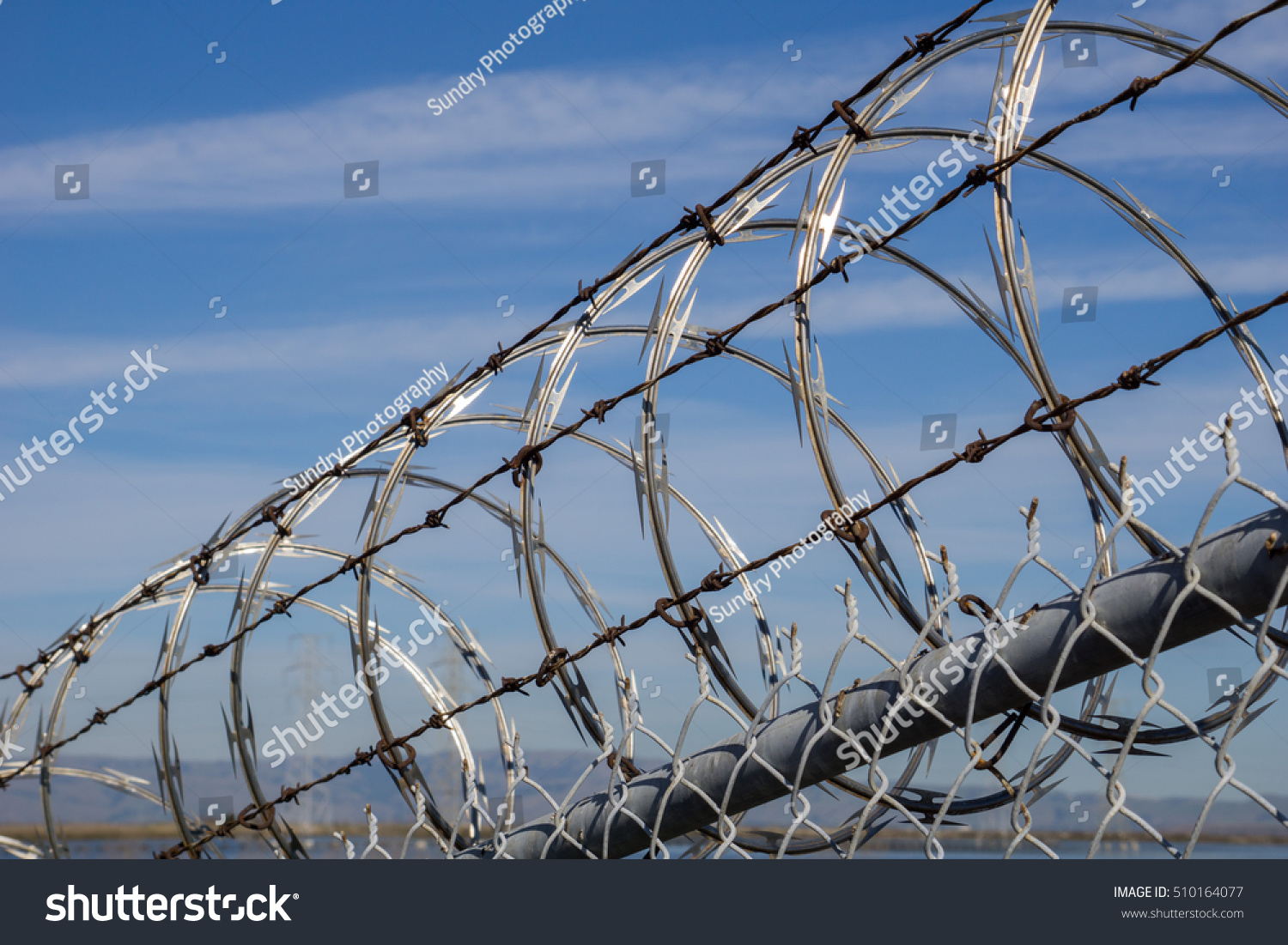 Barbed wire against a blue sky   EZ Canvas