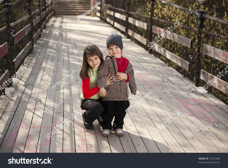 couple cute boy girl on bridge stock photo (royalty free) 51031966