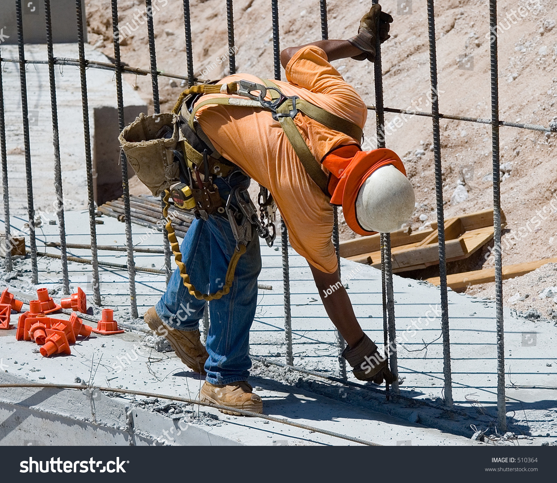 worker tying rebar