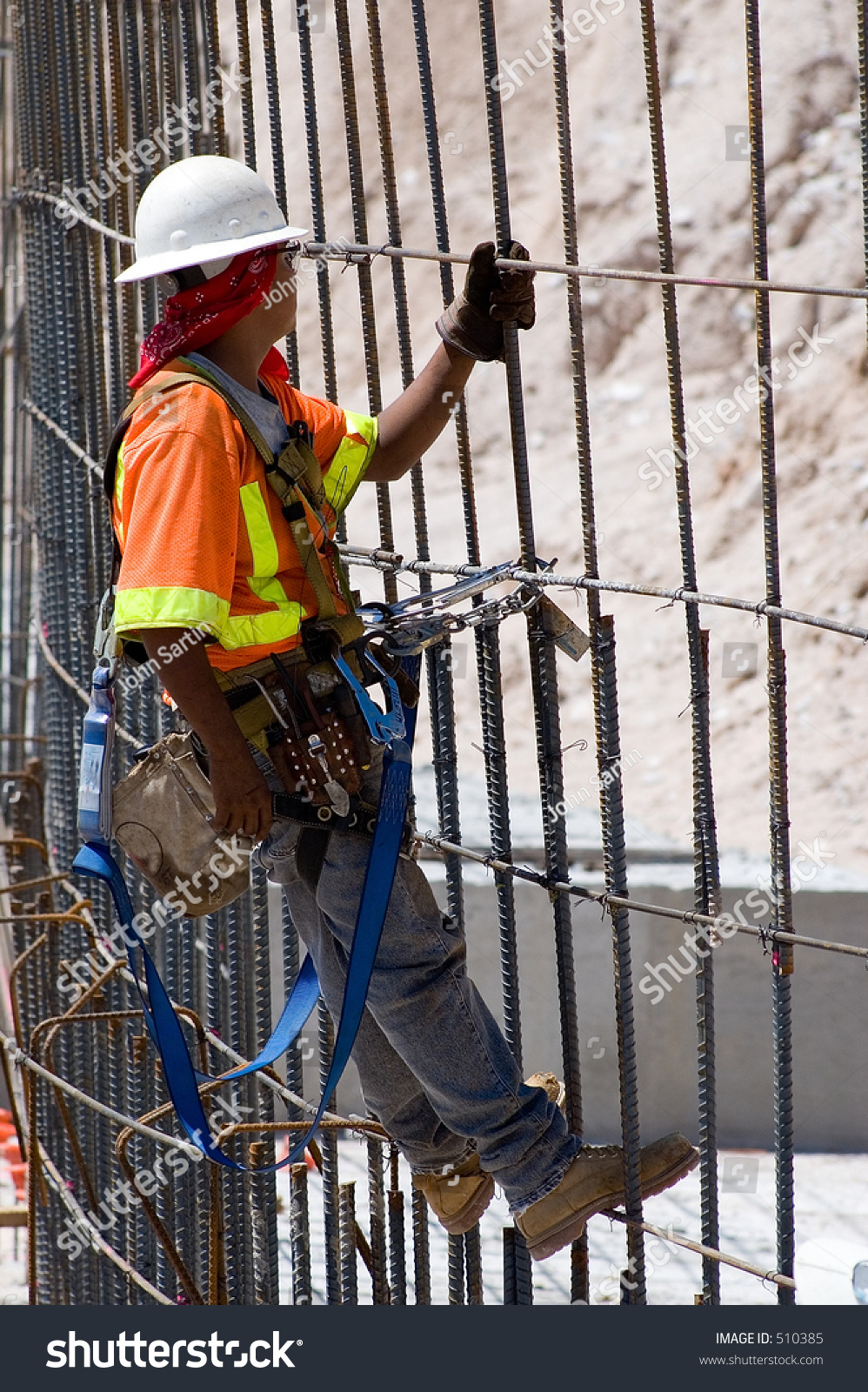 construction worker tying rebar for concrete reinforcement on a road construction project
