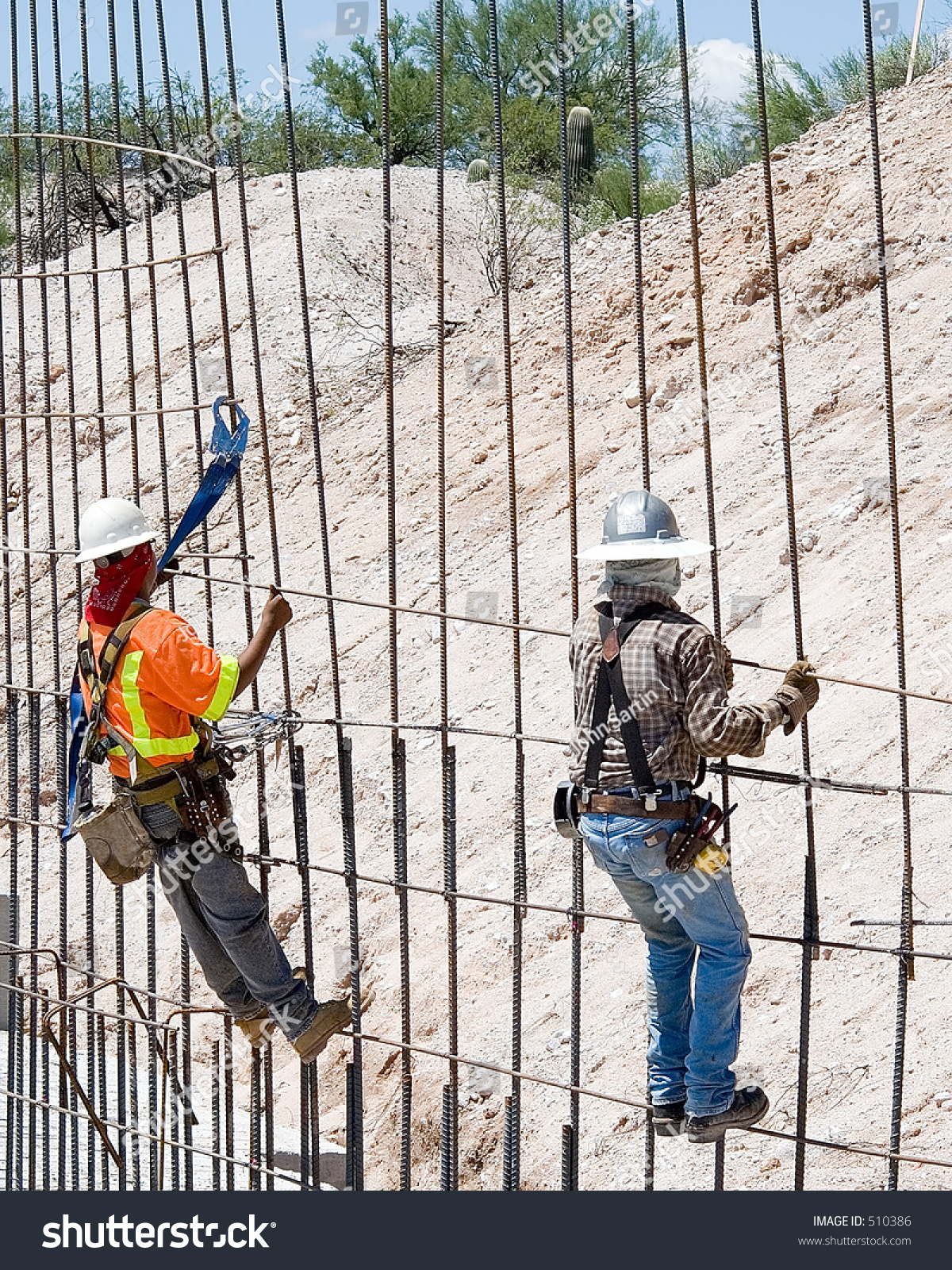 construction workers tying rebar for concrete reinforcement on a road construction project rebar worker
