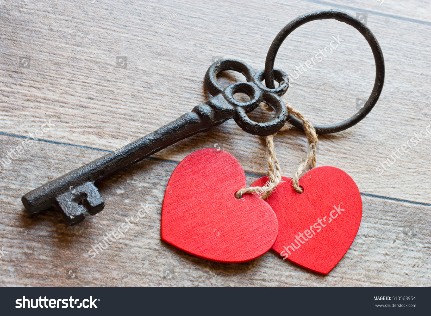 Key two hearts symbol love on stock photo 510568954 shutterstock key with two hearts as a symbol of love on the wooden background key of biocorpaavc Images