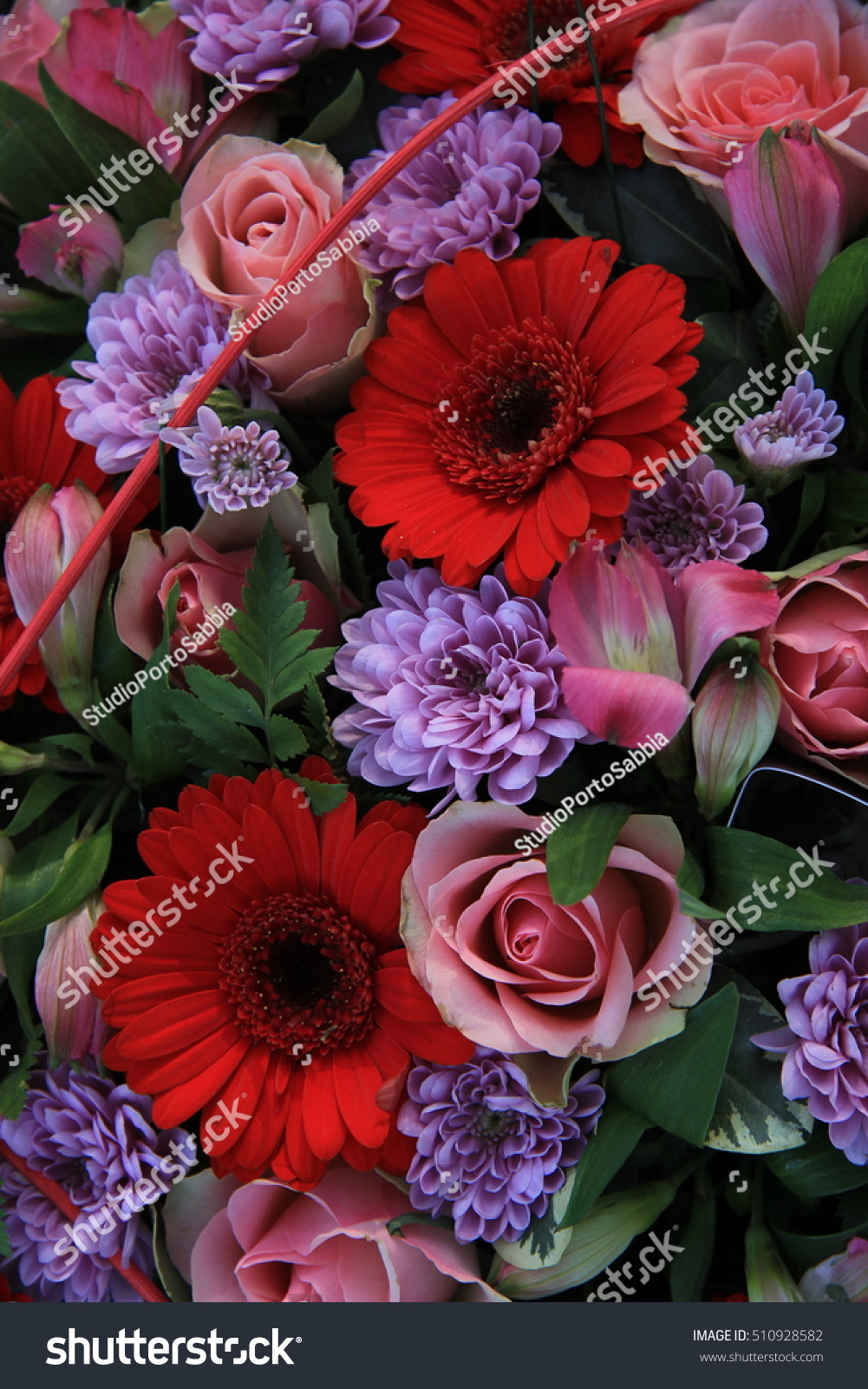 Mixed Flower Arrangement Various Flowers In Red And Pink For A