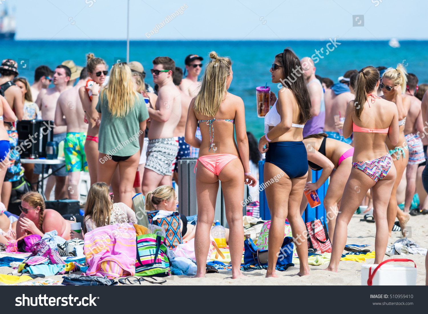 FORT LAUDERDALE, FL - JANUARY 2016: Boys and girls enjoy the beach on a