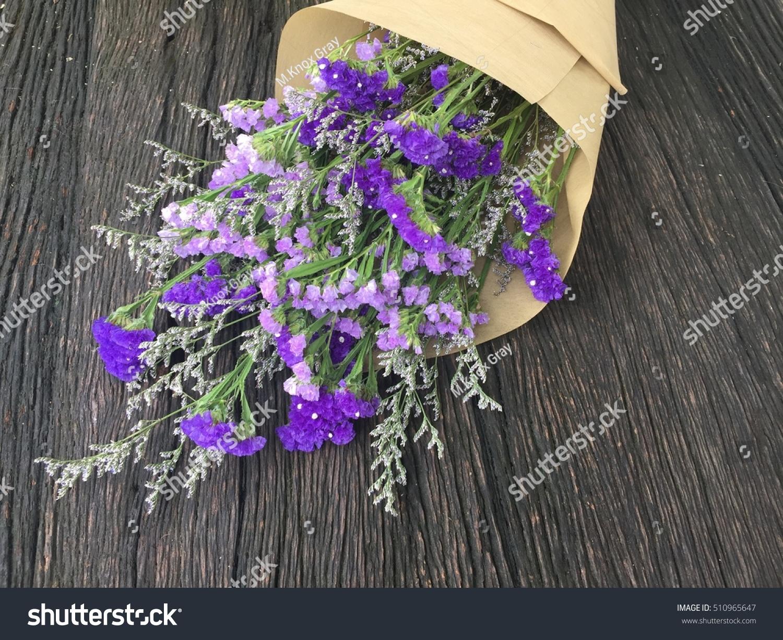 Purple flower bouquet on wood background stock photo royalty free purple flower bouquet on wood background izmirmasajfo