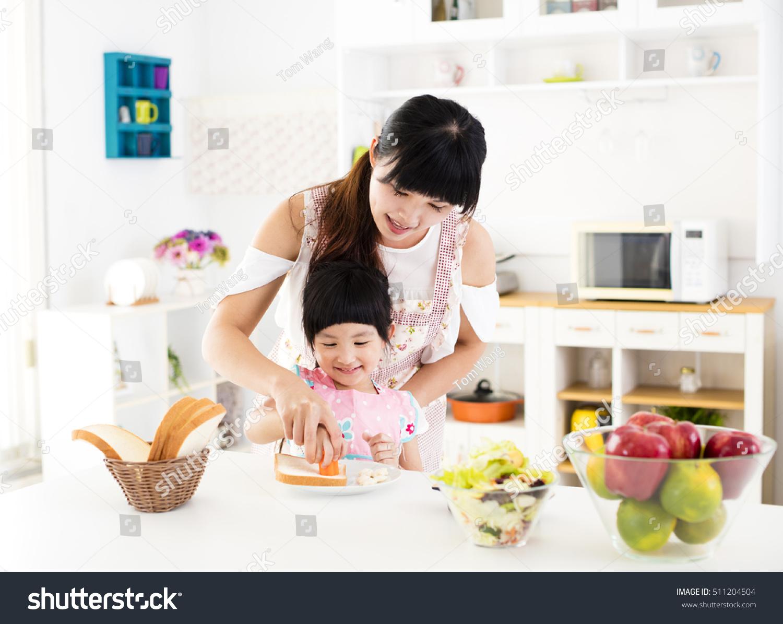 Little Girl Helping Her Mother Prepare Stock Photo 511204504 Shutterstock